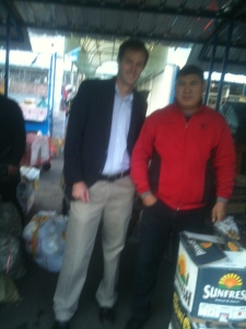 A blurry photo of me and the man I sell our fruit to. I'm on my way to work and thus a bit overdressed for the occasion.