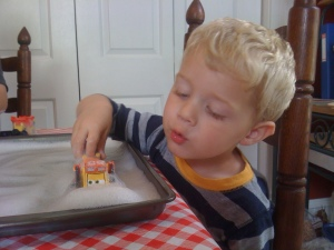 My youngest loved pushing the soap foam around with his bulldozer. This activity held his attention the longest.